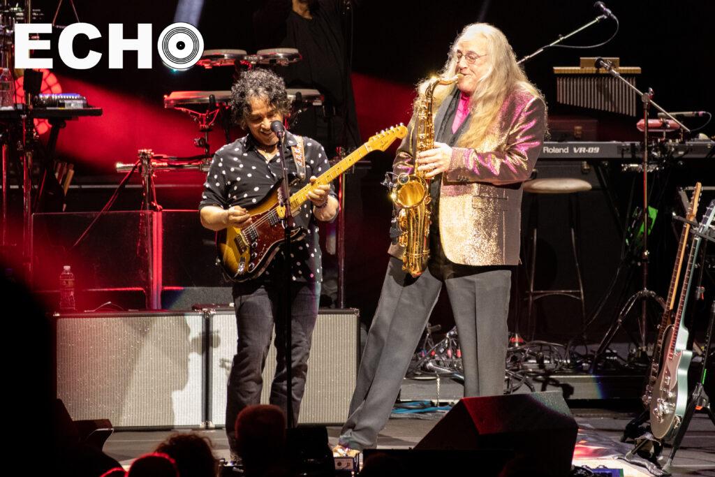 John Oates plays along to saxophone solo